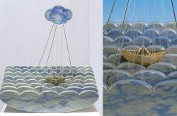 Fugge e s'appressa, 1995, marmo azul macauba, bronzo e plexiglass cm h 50x50x16